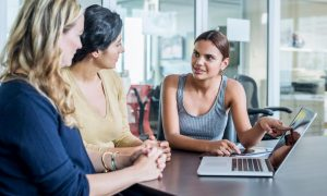 Employee Completing Screening Policy To Employers