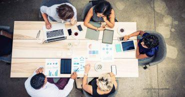 Executives reviewing finance checks