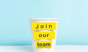 Paper cup with 'join our team' label
