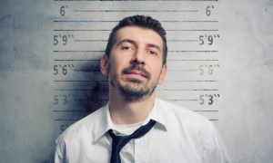 Employee with criminal record mugshot